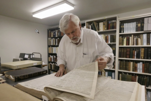 Bob Hirst, the general editor of the Mark Twain Project, with a book of 1866 Sacramento Union newspapers at the Bancroft Library at the University of California at Berkeley. (Jeff Chiu/AP)